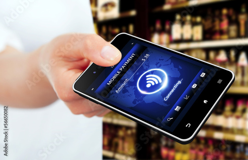 hand holding mobile phone with mobile payment screen