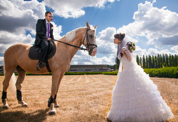 Young groom on horseback going to his bride