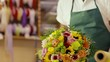 client paying florist in flower shop with credit card