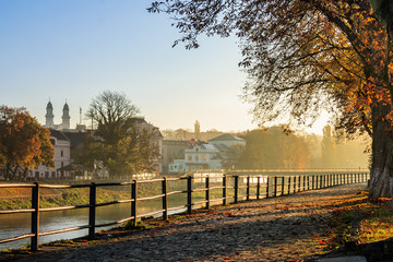 autumn morning on old town embankment filled with light