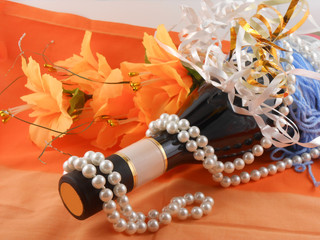 flowers, white diamonds and a champagne bottle