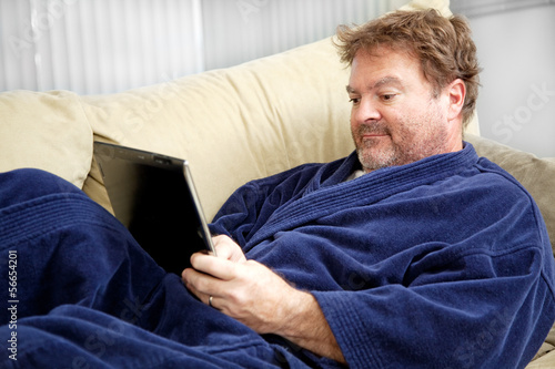 Casual Man Using Tablet PC
