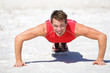 Push-ups - Fitness man crossfit training outdoors