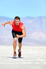 Running man - runner sprinting in desert