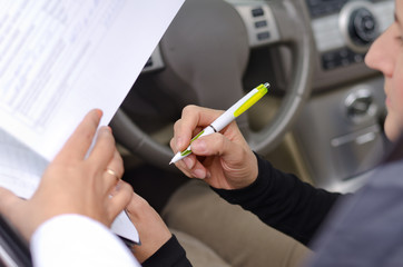 Woman driver signing paperwork