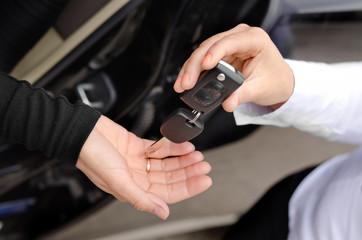 Woman handing over a set of car keys