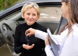 Saleslady handing over the keys