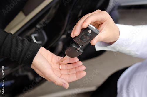 Woman handing over a set of car keys