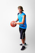 Teenager boy playing with basket ball