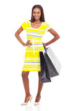 african american fashion model posing with shopping bags