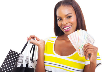 african woman holding a hand full of cash