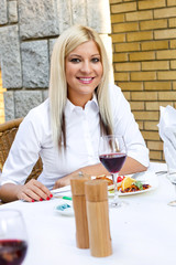 blonde woman in restaurant