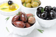 black, green and kalamata olives in a bowl close-up