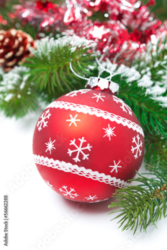 composition with red Christmas ball and fir branches