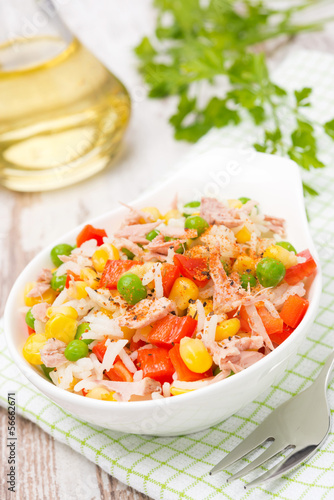 salad with corn, green peas, rice, red pepper and tuna in a bowl