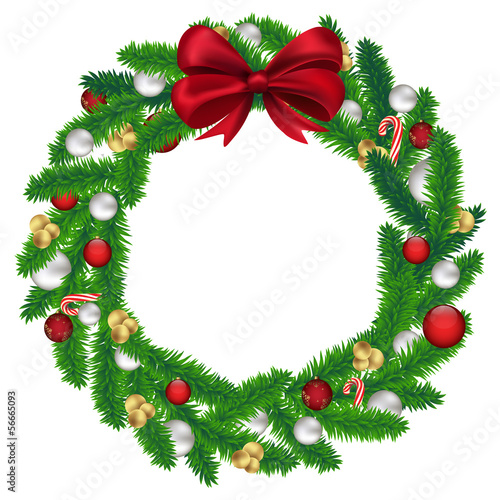 Christmas wreath of fir tree with balls, candy and a red bow