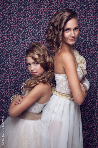 Woman and little girl models posing in white clothes