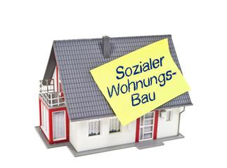 Haus mit Zettel und sozialer Wohnungsbau