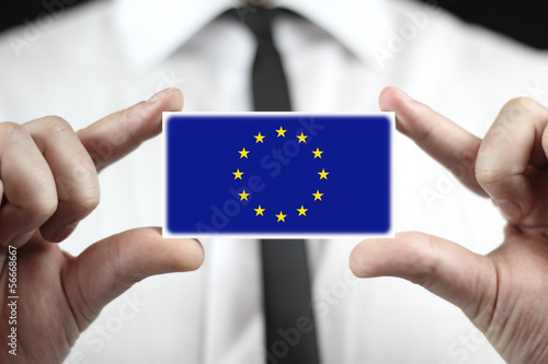 Businessman holding a business card with a European Union Flag