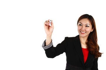 Asian businesswoman drawing graph, on white background in suit.