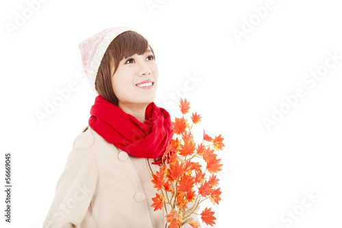 young smiling woman with yellow maple leaf