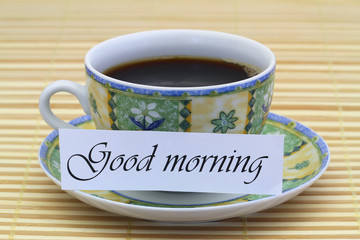 Good morning card with cup of coffee on bamboo mat