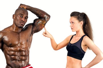 Beautiful woman impressed by the muscles of a bodybuilder