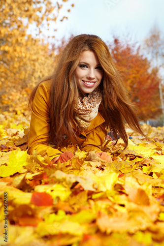 autumn woman on leafs
