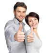 Portrait of happy couple with thumbs up sign