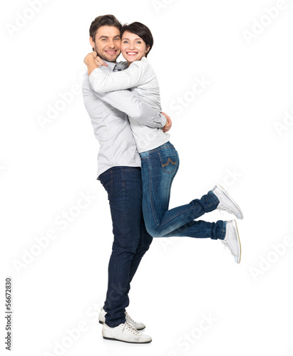 Full portrait of happy couple isolated on white