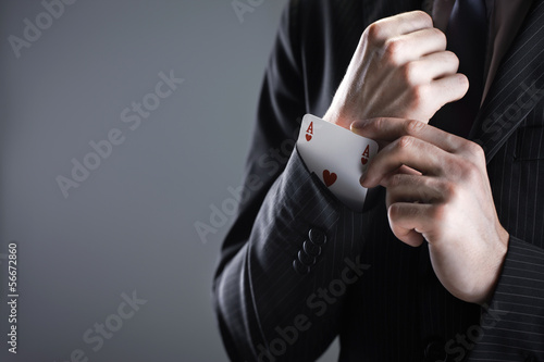 Businessman with ace card