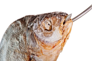 head of salted fish with a hook in his mouth