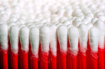 symmetrical rows of clean cotton swabs red
