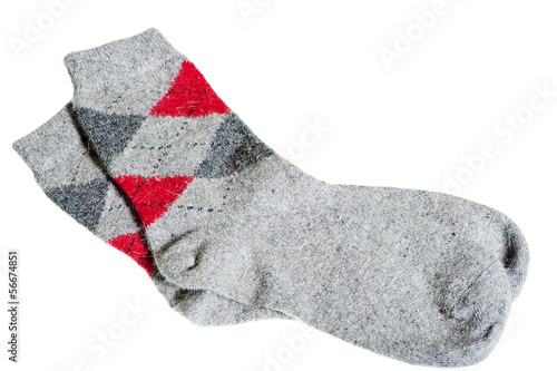 knitted warm winter socks on a white background