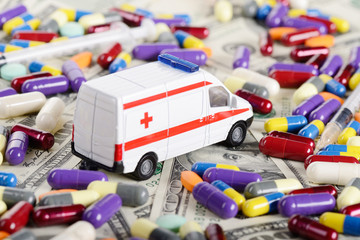 Ambulance car toy ride through dollars, pills and syringes