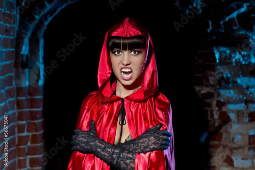 Halloween. Bloodthirsty Vampire Beautiful Woman in the dungeon