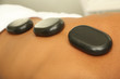 Hot stones on back before massage close up
