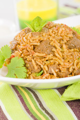 Mutton Byriani - Lamb and rice cooked with spices.