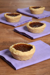 Butter tarts on purple napkin