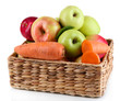Sweet apples and carrots in basket isolated on white