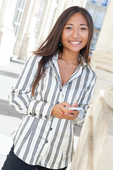 Pretty asian woman text messaging