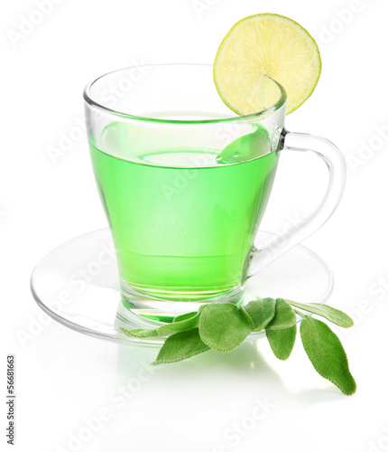 Transparent cup of green tea with sage and lime isolated