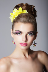 Showy Woman with Vivid Colorful Makeup and False Long Eyelashes
