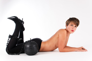 topless woman with prison ball on her leg