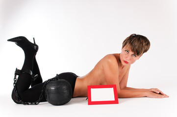 topless woman with prison ball on the leg and with a tag