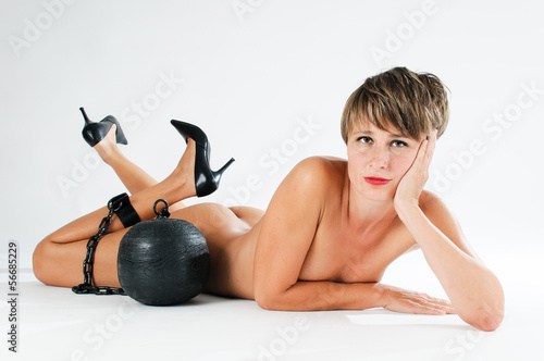 naked woman with prison ball on her leg