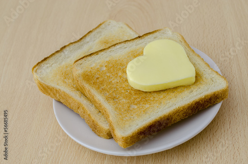 Heart shaped butter on toast