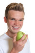 Sporty guy eating an apple