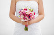 wedding bouquet of roses and eustoma in the hands of the bride