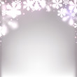 Christmas background with defocused snowflakes.